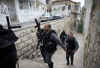 Israeli police officers patrol near a house purchased by Jews in east Jerusalem