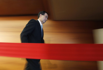 Bank of Japan Governor Shirakawa leaves a venue after his news conference in Tokyo