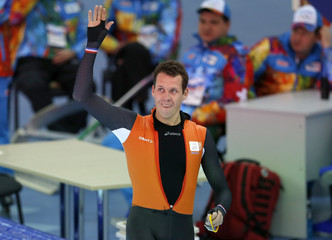 Stefan Groothuis of the Netherlands reacts after competing in the men's 1,000 meters speed skating race during the 2014 Sochi Winter Olympics