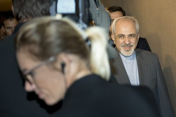 Iranian Foreign Minister Mohammad Javad Zarif makes his way to a meeting during the third day of closed-door nuclear talks at the Intercontinental Hotel in Geneva
