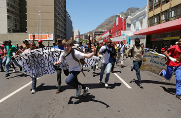Students protest outside the parliament ahead of South African Finance Minister Pravin Gordhan's medium term budget speech in Cape Town