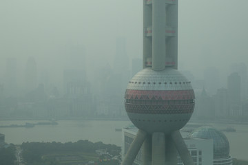 The Oriental Pearl TV Tower is seen amid heavy smog at Pudong financial district in Shanghai