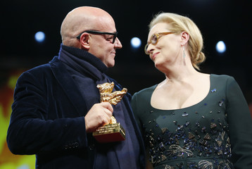 Director Rosi holds the Golden Bear award for the Best Film for the movie 'Fuocoammare' (Fire at Sea) as he stands with as he stands with jury president and actress Streep during the awards ceremony of the 66th Berlinale International Film Festival in Berl