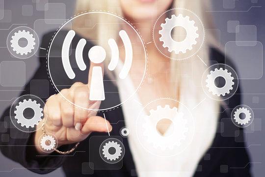 Businesswoman presses button wifi gear engineering network interface wi fi