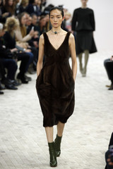 A model presents a creation by British designer Philo for fashion house Celine as part of her Fall-Winter 2013/2014 women's ready-to-wear fashion show during Paris fashion week