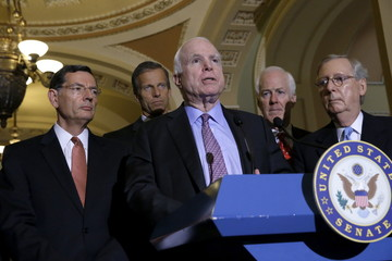 McCain joins McConnell to make comments on military authorization legislation to reporters at the U.S. Capitol in Washington