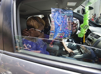 Lesley McSpadden, the mother of dead teenager Michael Brown, is overcome with emotions as she holds a drawing of her son while leaving a news conference in St. Louis, Missouri
