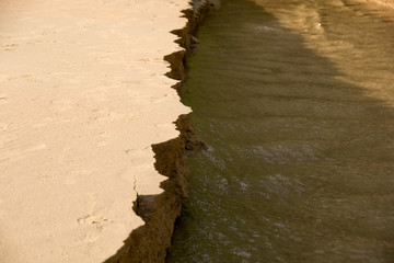 Close up Sandbank was eroded with water.