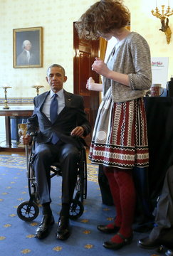 Obama tries out a lever-style wheelchair extensive designed by Reed as he plays host to the 2015 White House Science Fair at the White House in Washington