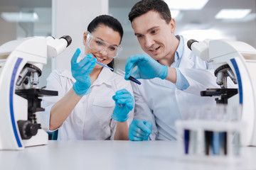 Delighted female researcher taking blue reagent