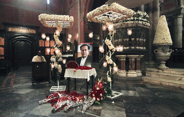 A portrait of the assassinated Governor of Punjab Taseer is adorned with lights and flowers during a Sunday service at the Cathedral Church of the Resurrection in Lahore