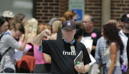 A supporter of U.S. Army Private First Class Bradley Manning gestures outside the courthouse at Fort Meade, Maryland