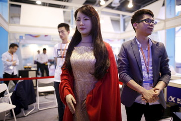 Humanoid robot Jiajia produced by University of Science and Technology of China is displayed at an exhibition stage during the 4th China (Shanghai) International Technology Fair 2016 in Shanghai
