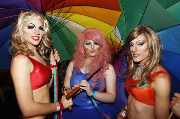 Revellers pose for pictures during the 34th annual gay and lesbian Mardi Gras parade in central Sydney