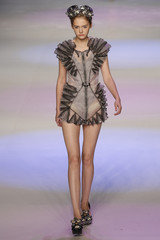 A model presents a creation by Law Hau-sin collection during Hong Kong Fashion Week in Hong Kong