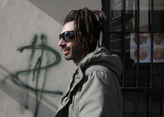 Del Paso walks past a graffiti in Madrid