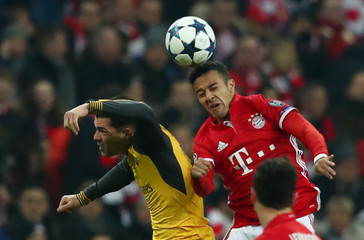 Bayern Munich's Thiago Alcantara in action with Arsenal's Granit Xhaka