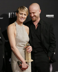 """Wright holds her award for Best Actress in a TV Series, Drama for her role in """"House of Cards"""" as she poses with Foster after the 71st annual Golden Globe Awards in Beverly Hills"""