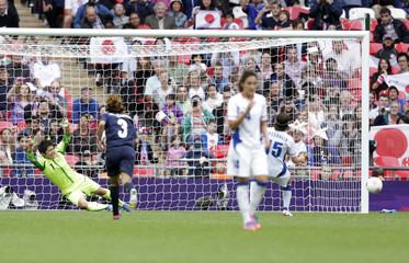 France's Bussaglia misses a penalty kick against Japan in the women's semi-final soccer match at Wembley Stadium in London