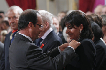 France's President Hollande awards Hidalgo, Paris deputy Mayor, with the Chevalier of the Legion of Honour during a ceremony at the Elysee Palace in Paris