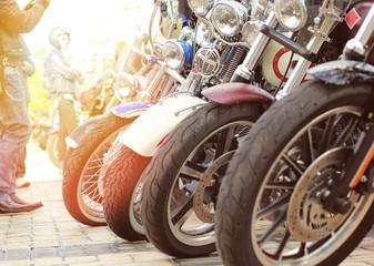 Row of vintage motorbikes close up sunset