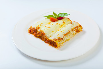 italian lasagna rolls on a white plate