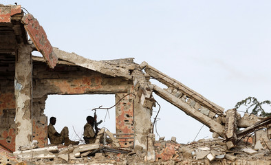 African Union soldiers take position in a destroyed building in Mogadishu