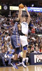 Mavericks forward Nowitzki shoots over Bobcats forward Maggette during their NBA basketball game in Dallas, Texas