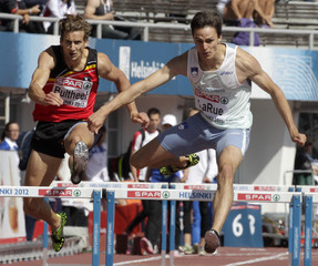 Brent Larue of Slovenia competes to win near Michael Bultheel of Belgium during the men's 400 metres hurdles heats at the European Athletics Championships in Helsinki