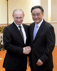 Russian President Putin shake hands with Chairman of China's NPC Wu Bangguo at the Great Hall of the People in Beijing