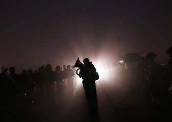 Band members of Indian security forces rehearse for Republic Day parade on foggy winter morning in New Delhi