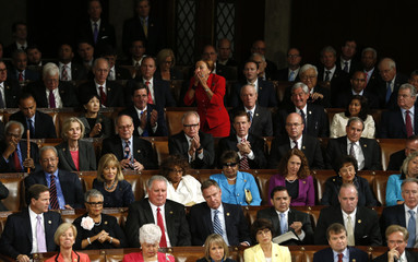 U.S. Congresswoman Nydia Velazquez leaps to her feet as Pope Francis calls for the end of the death penalty while addressing joint meeting of Congress on Capitol Hill in Washington