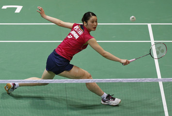 Japan's Mitani returns a shot to China's Xuerui during their women's singles final match in the Uber Cup badminton championship in New Delhi