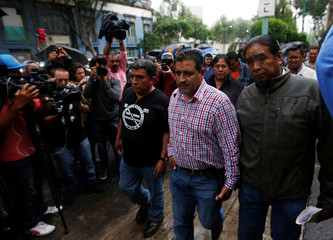 Representatives from the National Coordination of Education Workers (CNTE), arrive at the Interior Ministry building to attend a meeting between members of the CNTE and Mexico's government, in Mexico City