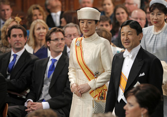 Crown Prince Naruhito and Crown Princess Masako of Japan arrive to the Nieuwe Kerk church in Amsterdam before the religious crowning ceremony