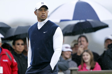 Tiger Woods stands on the third tee during the first round of a PGA Tour golf tournament in San Martin