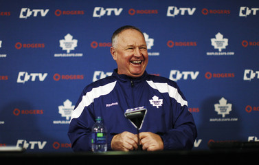 Head coach Carlyle of the Maple Leafs speaks at a news conference in Toronto