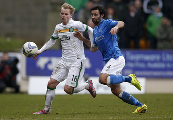Celtic's Gary MacKay-Steven challenges Simon Lappin during their Scottish Premier League soccer match at McDiarmid Park Stadium in Perth, Scotland