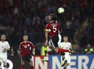Switzerland's Haris Seferovic fights for the ball with Albania's Lorik Cana during their 2014 World Cup qualifying soccer match at Qemal Stafa stadium in Tirana