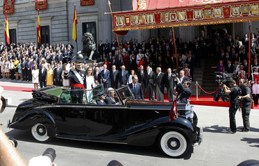 Spain's new King Felipe VI and his wife Queen Letizia parade through the streets of Madrid from the Congress of Deputies to the Royal Palace