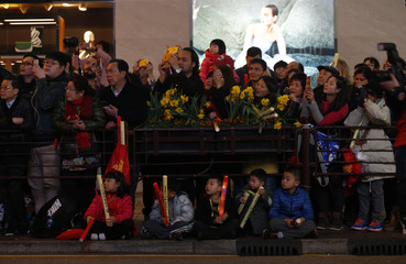 Spectators look on during a Lunar New Year parade in Hong Kong