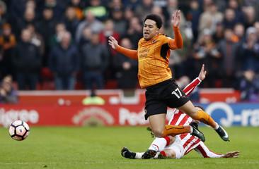 Wolverhampton Wanderers' Helder Costa in action with Stoke City's Xherdan Shaqiri