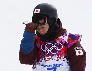 Japan's Ryo Aono reacts during men's snowboard halfpipe qualification round at 2014 Sochi Winter Olympic Games in Rosa Khutor