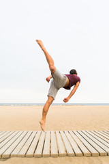 Man practicing jumps on beach