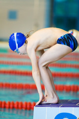 boy on start of swimming