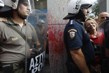 A doctor takes part in a anti-austerity protest outside Finance Ministry in Athens