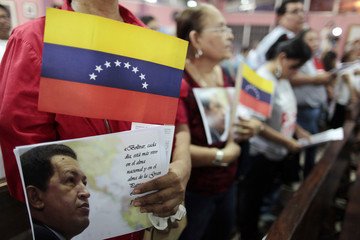 People take part in a mass to commemorate Venezuela's president Chavez on the one-month anniversary of his death, in Managua