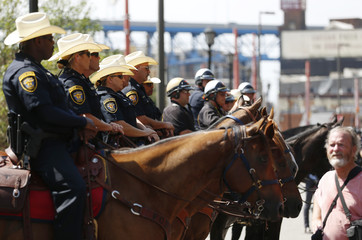 Mounted police officers maintain a barrier between opposing demonstrators near the Republican National Convention in Cleveland