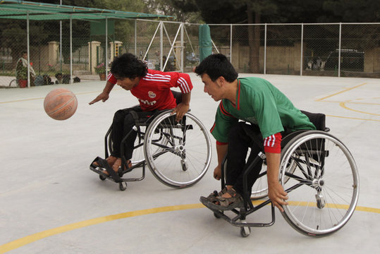 Disabled Afghans on wheelchairs play basketball in Kabul
