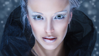 Fashion model with winter snow make-up